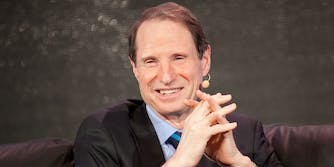 Ron Wyden smiling on couch