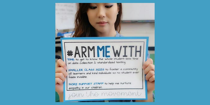 """Teacher holding sign with #ArmMeWith """"Time, Smaller Class Sizes, More Support Staff"""" sign"""