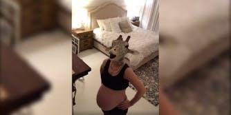 'April the Giraffe' emulator Erin Dietrich walks around her bedroom in a giraffe mask