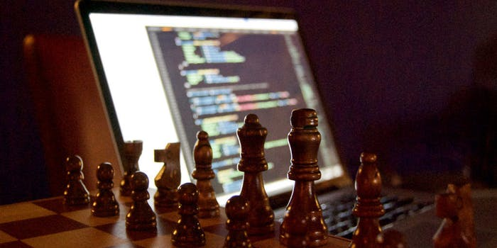 Chess board with computer code in background