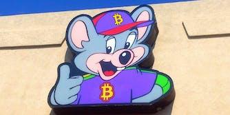 Chuck E Cheese with Bitcoin logo