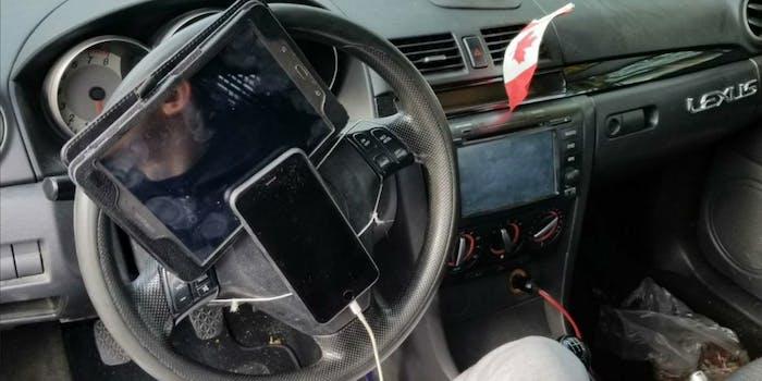apple iphone galaxy tablet on steering wheel