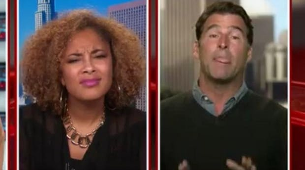 Amanda Seales scrunching up her face in disgust