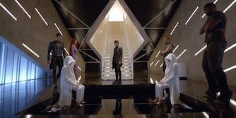 Inhumans standing in a room