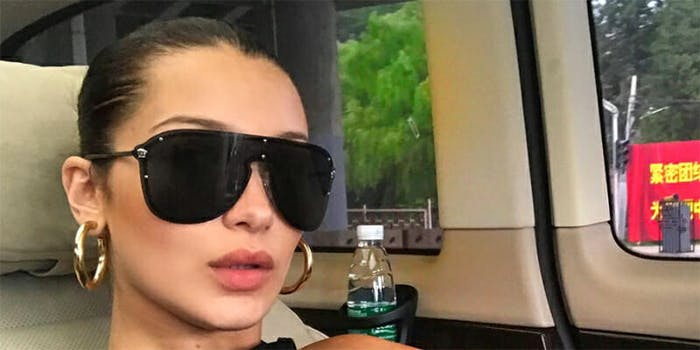 People speculated about whether Bella Hadid intentionally included a political Chinese banner in an Instagram selfie.