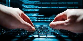 Hands typing code