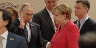 Vladimir Putin and Angela Merkel at G20 summit
