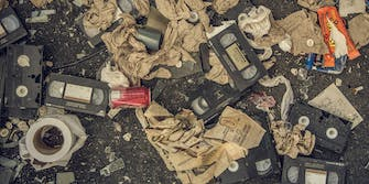 VHS tapes mixed with trash on the ground