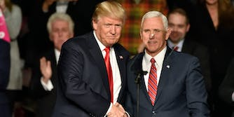 Donald Trump and Mike Pence Shaking Hands at a Rally