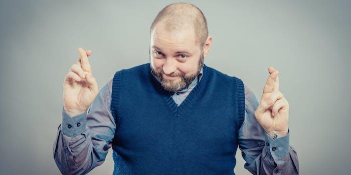 Bald Man Crossing His Fingers
