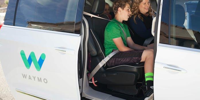 Family sitting in a Waymo van