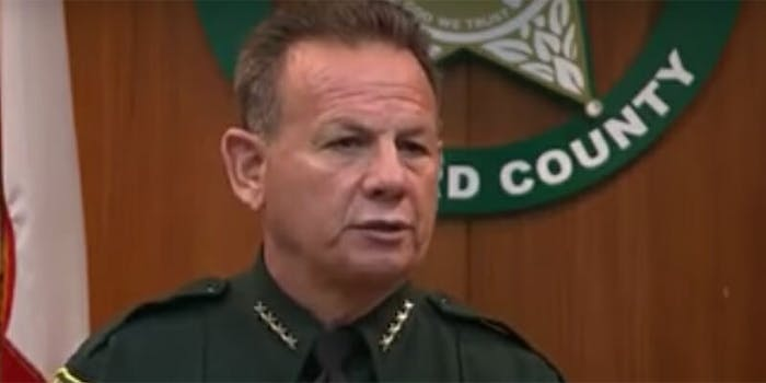 After Broward County Sheriff Scott Israel reported that the armed deputy at a Florida high school 'did nothing' during a mass shooting, armed police are guarding the deputy's home.