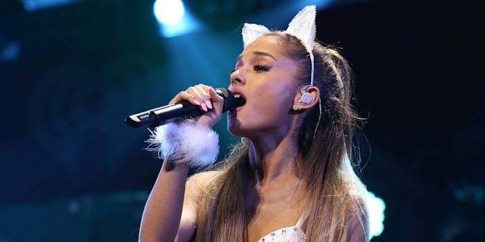 Ariana Grande wearing cat ears while singing