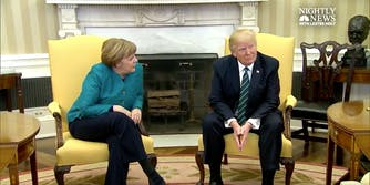German Chancellor and U.S. President Donald Trump sit together for a photo op before their press conference, though Trump ignore's Merkel's question.