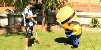 Man holding shovel wagging finger at Minion