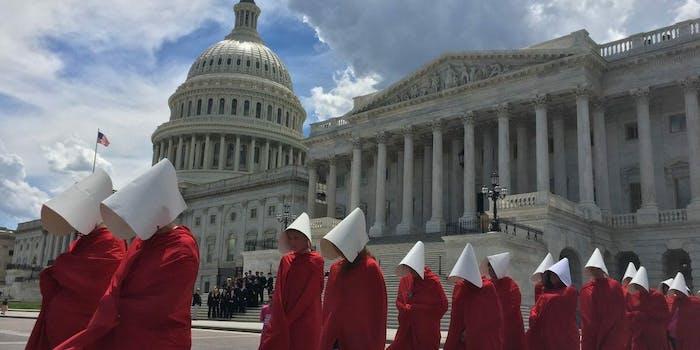 'Handmaids' protesting the Senate GOP healthcare bill at Washington D.C.