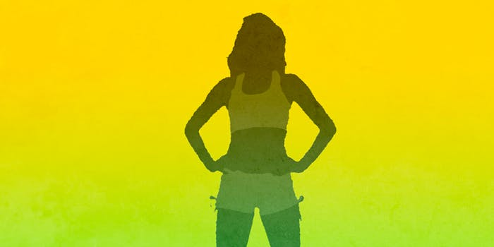 A woman's silhouette standing in a power pose
