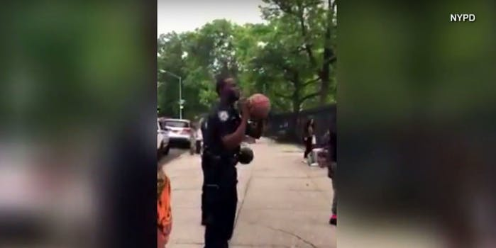 nypd cop basketball shot