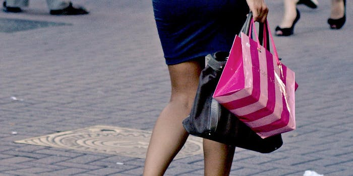 Woman walking with Victoria's Secret shopping bag