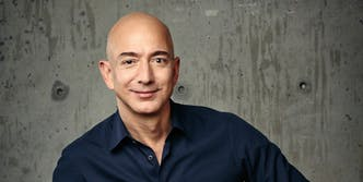 Jeff Bezos in navy shirt and blue jeans