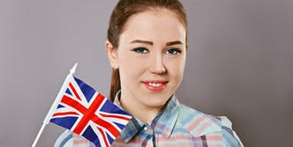 Woman holding the UK flag