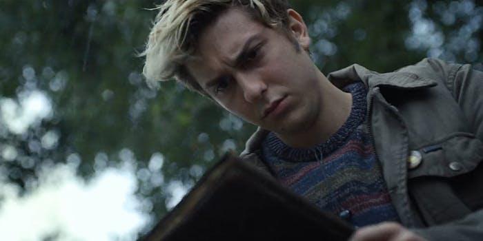 Young man looking at book